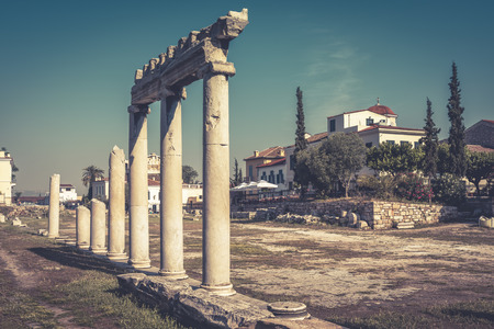 Panorama of the Roman Agora in summer, Athens, Greece. It is one of the main tourist attractions of Athens. Scenery of ancient Greek ruins in Athens center near Plaka district. The vintage photo. Stock Photo