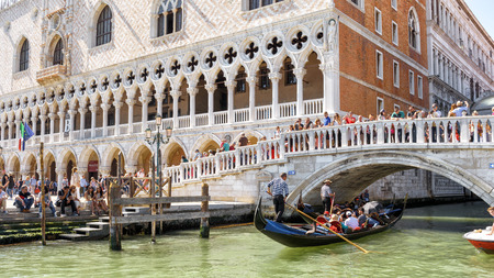 Venice, Italy - May 21, 2017: Panoramic view of Doge's Palace in Venice. It is one of the main tourist attractions of Venice. Sunny waterfront in Venice with Doge's Palace and gondola in summer. Sajtókép