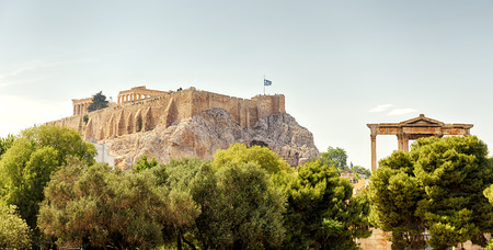 Panoramic view of the Acropolis hill, Athens, Greece. It is the main tourist attraction of Athens. Scenic panorama of Athens with ancient Greek ruins. Scenery of the famous place of Athens in summer.