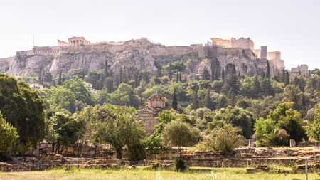 Panorama of the Agora overlooking famous Acropolis hill, Athens, Greece. Panoramic view of Acropolis in the Athens center in summer. Ancient Greek ruins are the main tourist attraction of Athens.