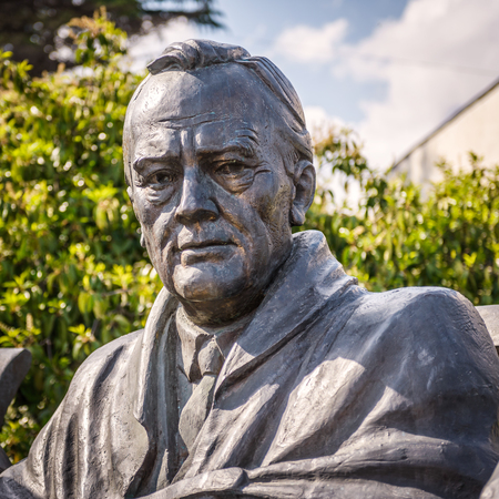 Yalta, Crimea - May 17, 2016: Statue of Franklin Delano Roosevelt by Tsereteli in Livadia Palace, Crimea, Russia. Famous Conference was held here in 1945. Portrait of president USA Roosevelt close-up.