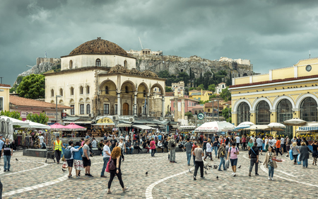 Athens - May 7, 2018: Monastiraki square overlooking Acropolis in Athens, Greece. People visit an old center of Athens in summer. This historical area is one of the main tourist attractions in Athens.