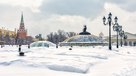 Moscow - Feb 5, 2018: Cityscape of Moscow in winter, Russia. Manezhnaya Square near Moscow Kremlin during snowfall. Panoramic view of the Moscow center. Scenery of snowy Moscow city. Editorial