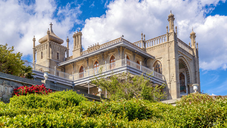 Crimea - May 20, 2016: Vorontsov Palace with beautiful garden in Crimea, Russia. Vorontsov Palace is one of the main landmarks of Crimea. Panoramic view of historical architecture of Crimea in summer. Editorial