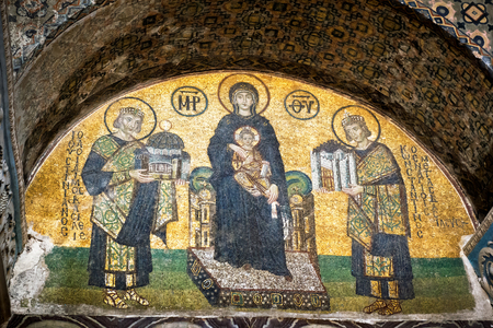 Istanbul - May 25, 2013: Golden mosaic inside the Hagia Sophia, Turkey. Old Eastern Orthodox art. Ancient Hagia Sophia is a top landmark of Istanbul. Image of Virgin Mary in the Hagia Sophia interior. Editorial