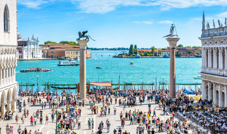 Venice, Italy - May 21, 2017: People visit the embankment at the Piazza San Marco in Venice. This place is a top tourist attraction of Venice. Concept of traveling and vacation in summer Venice. Editorial