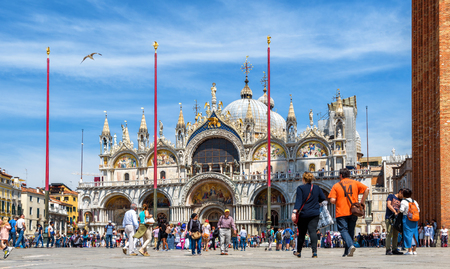 Venice, Italy - May 19, 2017: St Marks Basilica or San Marco in Venice. It is a main landmark of Venice. People visit the San Marco square in summer. Concept of traveling and vacation in Venice.
