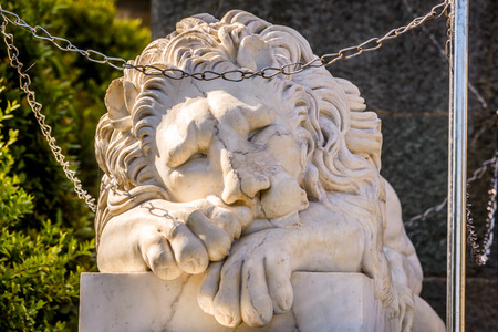 Alupka, Crimea - May 20, 2016: Marble statue of sleeping lion at the Vorontsov Palace in Crimea, Russia. This old palace is a landmark of Crimea. Beautiful stone sculpture of relaxing lion close-up.