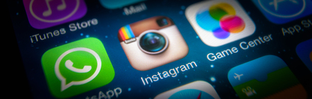 Moscow - March 11, 2019: Instagram logo on IPhone screen close-up. Application icon of Instagram social media on smartphone, macro view. Instagram and other mobile apps in digital device.