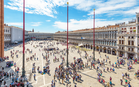 Venice, Italy - May 21, 2017: Piazza San Marco or St Marks Square in Venice. It is a top tourist attraction of Venice. Panorama of the famous Venice center with many people from above in summer.