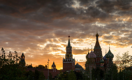 Moscow Kremlin and St Basil`s Cathedral at sunset, Russia. This place is a top tourist attraction of Moscow. Panorama of Moscow landmarks in summer evening. Old Moscow center at dusk for background.