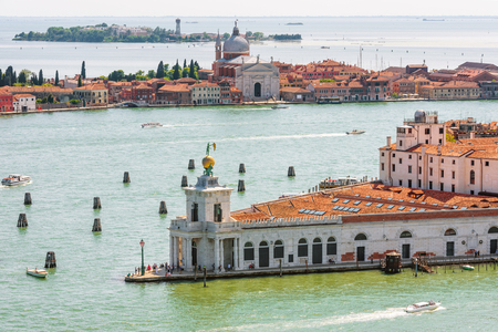 Panorama of Venice taken from above, Italy. Aerial view of the Grand Canal, islands and sea. Beautiful skyline of Venice in summer. Cityscape of Venice with old buildings surrounded by water.