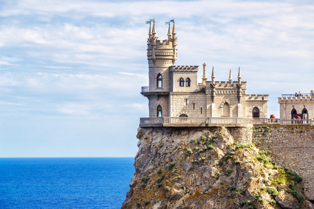 Castle of Swallow's Nest on a cliff, Crimea, Russia. It is a famous tourist attraction of Crimea. View of the Crimea landmark close-up in summer. Architecture and nature of Southern coast of Crimea.