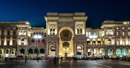 Galleria Vittorio Emanuele II at night, Milan, Italy. It is a famous landmark of Milan. Panorama of the Piazza del Duomo in the Milan center at dusk. Beautiful old architecture of Milan in evening.