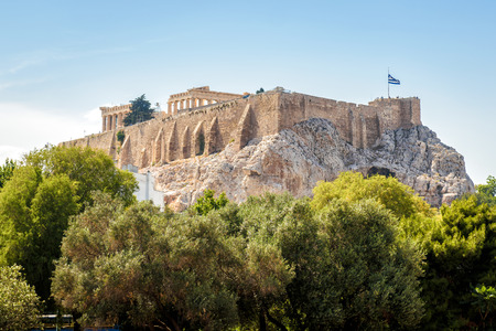 Acropolis of Athens in summer, Greece. It is a top landmark of old Athens. Scenic view of the Acropolis hill with Ancient Greek ruins in the Athens center. Remains of the antique Athens city. Stock Photo