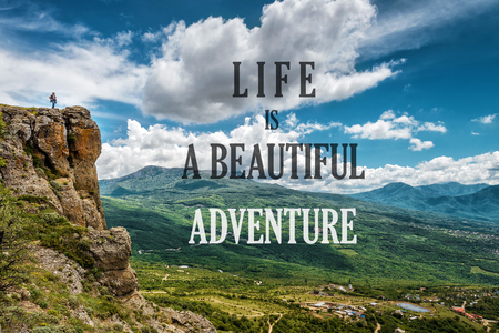 Inspirational motivational quote on the nature background. Text: Life is a beautiful adventure. Positive quote and beautiful mountain landscape. Concept of lifestyle and travel.
