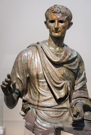Athens - May 7, 2018: Antique statue of emperor Augustus in the National Archaeological Museum in Athens, Greece. Classic bronze sculpture. Caesar Augustus is the famous Ancient Roman ruler.