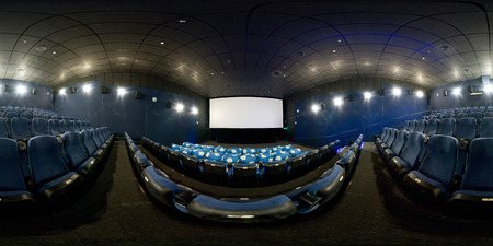 Moscow - Feb 10, 2012: 360 degrees full panorama of a modern cinema hall. 360 spherical view of movie theater interior with blue seats. Seamless panorama with equirectangular equidistant projection.