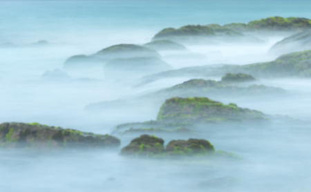 Tropical landscape as creative abstract blur background. Long exposure shot of sea stones. Panorama of mystery nature. Scenic view of water like fog and mist. Banco de Imagens