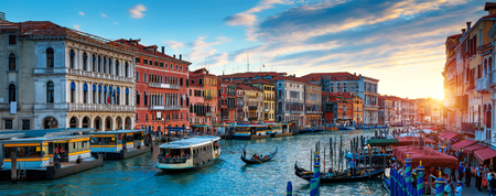 Panorama of Venice at sunset, Italy. Scenic view of Grand Canal in twilight. It is a top tourist attraction of Venice. Beautiful cityscape of Venice at dusk. Romantic water trip in Venice in evening.