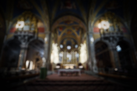 Interior of Catholic church as abstract creative blur background. Luxury altar and lights inside the church. Concept of religion, worship and prayer. Reklamní fotografie