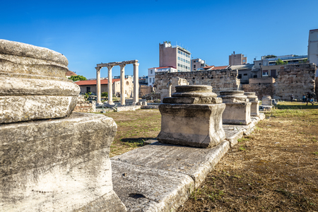Library of Hadrian in Athens, Greece. It is an old landmark of Athens. Panorama of Ancient Greek ruins in the Athens city center in summer. Remains of architecture of famous antique Athens.