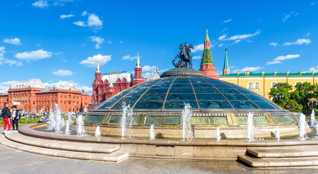 Moscow - May 19, 2019: Panorama of Manezhnaya Square in the Moscow city center, Russia. Modern cupola with St Georg statue overlooking the Moscow Kremlin. Cityscape of Moscow with fountains in summer.