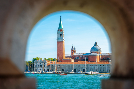 San Giorgio Maggiore church on the island, Venice, Italy. It is a historical landmark of Venice. View from the famous San Marco embankment. Old architecture of the Venice city in summer.