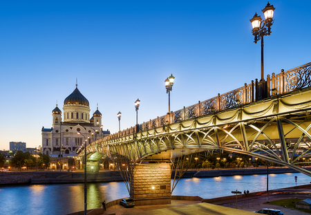Patriarshy Bridge and Cathedral of Christ the Savior in evening, Moscow, Russia. This place is a tourist attraction of Moscow. Beautiful panorama of Moscow landmarks. Night view of the Moscow city. Reklamní fotografie