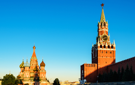 Moscow Kremlin and St Basils Cathedral on Red Square in sunset time, Russia. Old Kremlin is a top tourist attraction of Moscow. Beautiful sunny view of the famous Moscow landmarks. Travel concept.