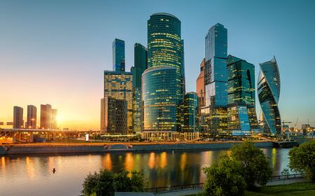 Scenic view of Moscow with skyscrapers of Moscow-City at sunset, Russia. Moscow-City is a business district on embankment of Moskva River. Cityscape of Moscow with modern tall buildings in evening.