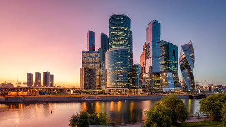Panorama of Moscow with skyscrapers of Moscow-City at sunset, Russia. Moscow-City is a business district on the embankment of Moskva River. Cityscape of Moscow with modern tall buildings at dusk.