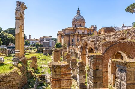 Forum of Julius Caesar in summer, Rome, Italy. It is one of the main tourist attractions in Rome. Scenic view of Ancient Roman ruins in the Rome city center. Old famous architecture of Rome. Фото со стока