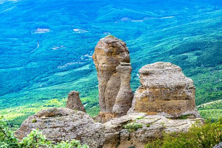 Landscape with stones of the Valley of Ghosts on Demerdji mountain, Crimea, Russia. It is a natural tourist attraction of Crimea. Scenic view of bizarre rocks in Southern coast of Crimea in summer.