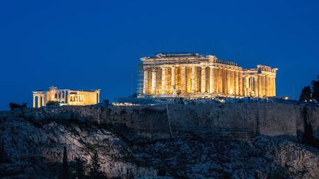 Parthenon at night, Athens, Greece. It is a top landmark of Athens. Famous old temple on Acropolis hill in evening. Illuminated classical Greek ruins close-up. Remains of ancient Athens city at dusk.
