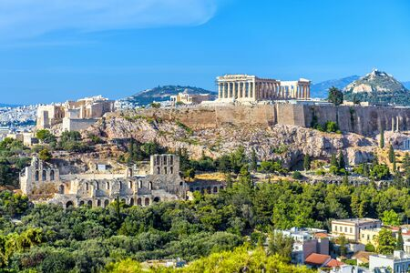 Athens in summer, Greece. Panorama of Acropolis hill. It is a top landmark of Athens. Scenic view of Ancient Greek ruins. Landscape of old Athens city with famous Parthenon. Skyline of Athens.