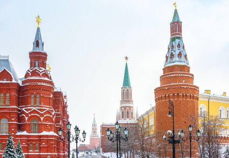 Moscow city center in winter, Russia. Manezhnaya Square overlooking Red Square, famous landmark of Moscow. Ancient towers of Moscow Kremlin during snowfall. Scenery of old Moscow buildings under snow. Stok Fotoğraf - 131362975