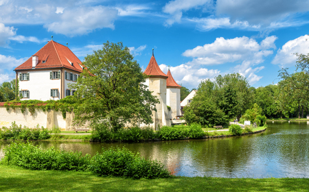 Blutenburg Castle in Munich, Germany. It is a tourist attraction of Munich city. Scenic panorama of old castle on Wurm River in Bavaria. Beautiful view of medieval architecture of Munich in summer.