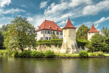 Blutenburg Castle in Munich, Germany. It is an old landmark of Munich city. Scenic view of medieval architecture of Munich in summer. Beautiful panorama of ancient castle on Wurm River in Bavaria.