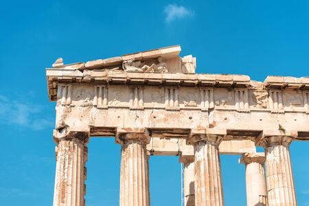 Parthenon temple closeup, Athens, Greece. It is a top landmark of Athens. Detail of facade with old relief. Ancient Greek ruins on sky background. Famous remains of classical Greek culture.