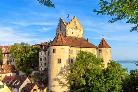 Meersburg Castle at Lake Constance or Bodensee, Germany. This old castle is landmark of Meersburg town. Scenic view of medieval German castle in summer. Scenery of Swabian tourist attraction.