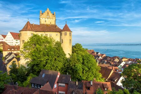 Medieval Meersburg Castle at Lake Constance or Bodensee, Germany. It is a landmark of Meersburg town. Landscape with old German castle in summer. Scenery of tourist attraction in sunset light.