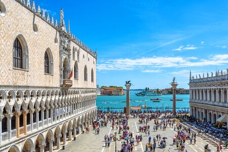 Venice, Italy - May 21, 2017: Doge`s Palace in summer in Venice. It is a famous landmark of Venice. Panoramic view of old Doge`s building, embankment and sea in the Venice city center.