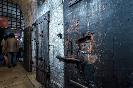 Venice, Italy - May 21, 2017: Old prison at the Doge`s Palace (Palazzo Ducale). It is famous tourist attraction of city. Historical dungeon with vintage doors. Inside the medieval prison of Venice. Editorial