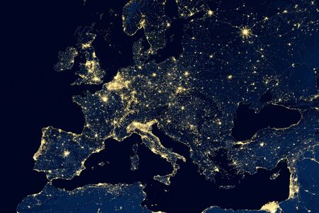 Earth at night, view of city lights showing human activity in Europe from space. EU and Mediterranean on world dark map on global satellite photo.