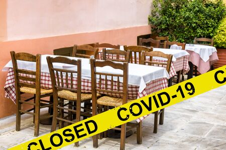 Street restaurant or cafe closed due to COVID-19 coronavirus disease. SARS-CoV-2 corona virus outbreak, countries impose quarantine and restrictions on movement during coronavirus pandemic.