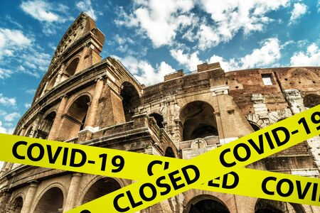 COVID-19 coronavirus in Italy, caution tape in photo of Colosseum in Rome. World tourist landmarks closed due to SARS-CoV-2 corona virus outbreak. COVID19 pandemic, quarantine and travel concept.