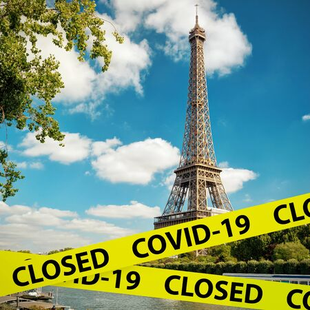 COVID-19 coronavirus in France, caution tape in photo of Eiffel Tower in Paris. World tourist landmarks closed due to SARS-CoV-2 corona virus outbreak. COVID19 pandemic, quarantine and travel concept.
