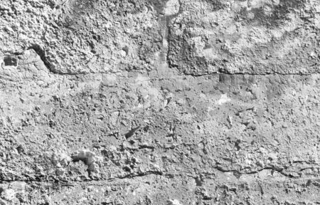Texture of concrete wall background, rough plaster or stucco. Grunge peeling wall of old building, vintage gray surface with weathered texture, abstract urban structure background in black and white.