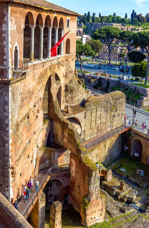 Rome - May 8, 2014: People visit House of Knights of Rhodes on Forum of Augustus, Rome, Italy. Old famous building in Roma center, tourist attraction of city, monument of medieval historical Rome.